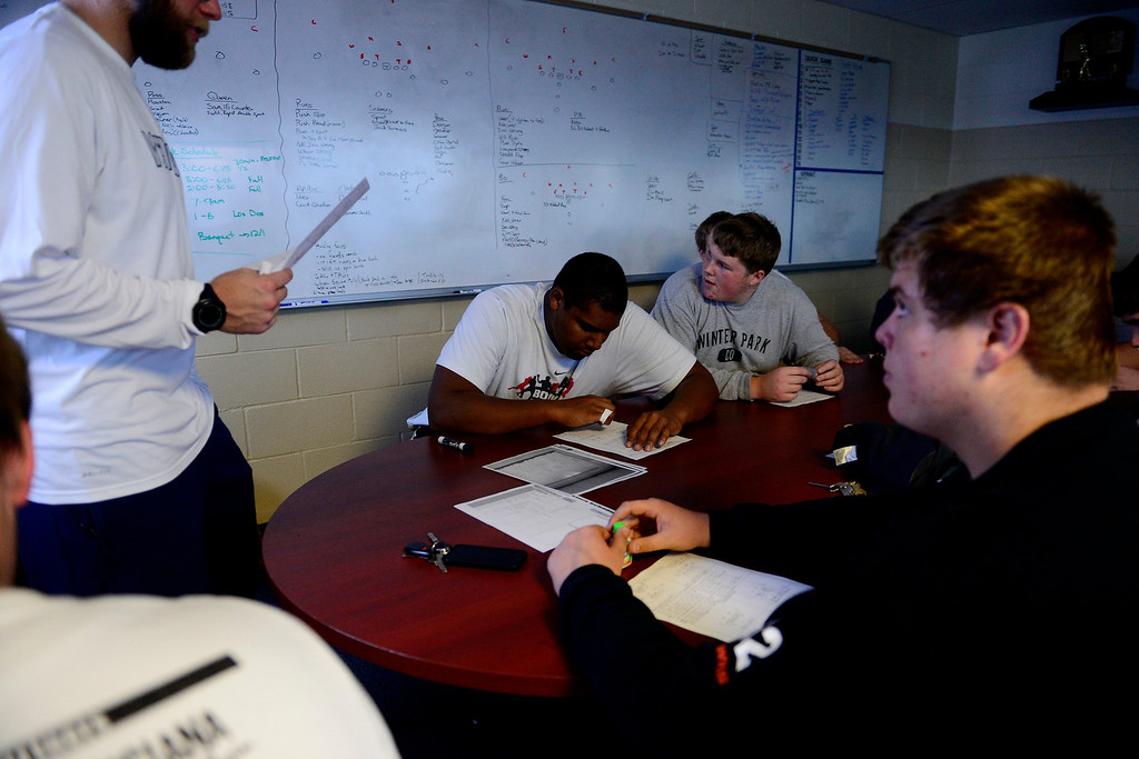 . Valor Christian starting right tackle Isaiah Holland looks over his notes during an offensive line meeting.  (Photo by AAron Ontiveroz/The Denver Post)