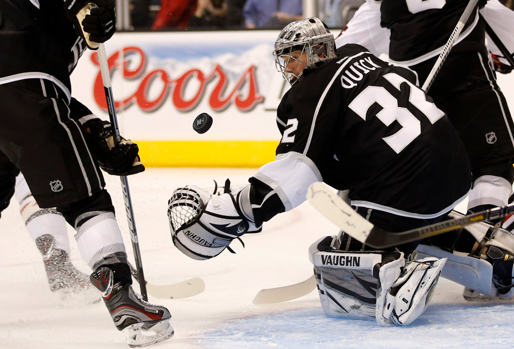 . Los Angeles Kings goalie Jonathan Quick looks at the puck during the first period of an NHL hockey game against the Chicago Blackhawks in Los Angeles, Saturday, Jan. 19, 2013. (AP Photo/Jae C. Hong)