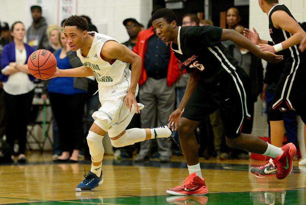 . Jervae Robinson (0) of Overland brings the ball up court as Ikenna Ozor (25) of EagleCrest  races by his side during the first half of play. The Overland Trailblazers hosted the Eaglecrest Raptors on Friday, January 8, 2016. (Photo by AAron Ontiveroz/The Denver Post)