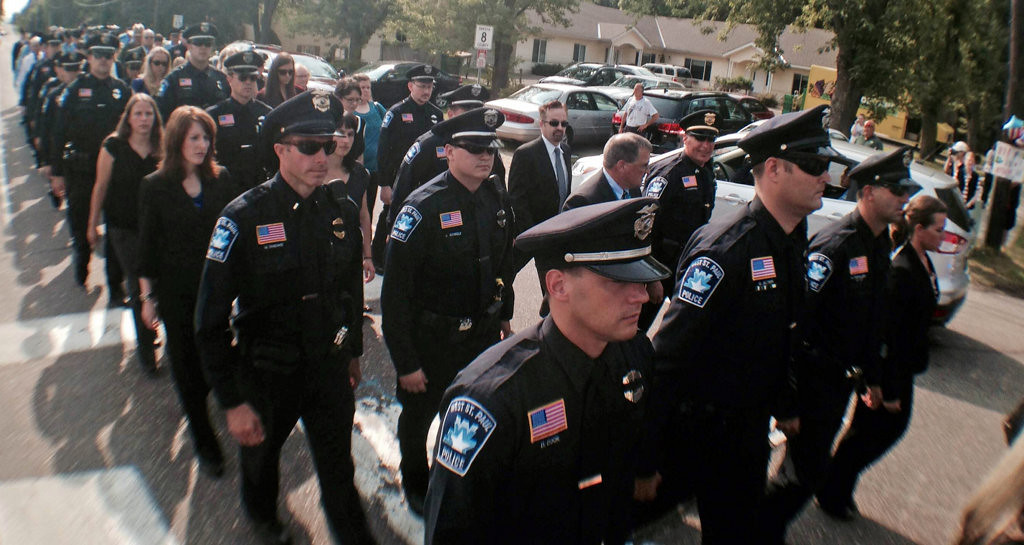 . Members of the West St. Paul police department arrive at St. Stephen\'s Lutheran Church in West St. Paul for the funeral of Mendota Heights police officer Scott Patrick on Wednesday. (Pioneer Press: Ben Garvin)