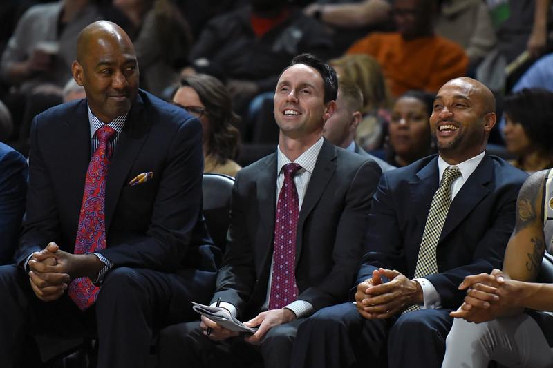 Coaches share a lighter moment.jpg