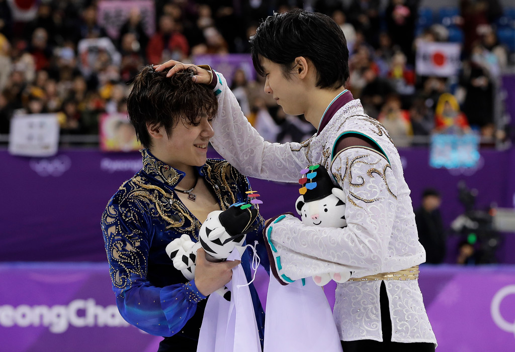 . Gold medal winner Yuzuru Hanyu, right, of Japan reacts with teammate and silver medalist Shoma Uno after the men\'s free figure skating final in the Gangneung Ice Arena at the 2018 Winter Olympics in Gangneung, South Korea, Saturday, Feb. 17, 2018. (AP Photo/David J. Phillip)
