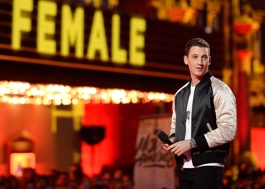 . Miles Teller presents the award for best female performance at the MTV Movie Awards at Warner Bros. Studio on Saturday, April 9, 2016, in Burbank, Calif. (Kevork Djansezian/Pool Photo via AP)