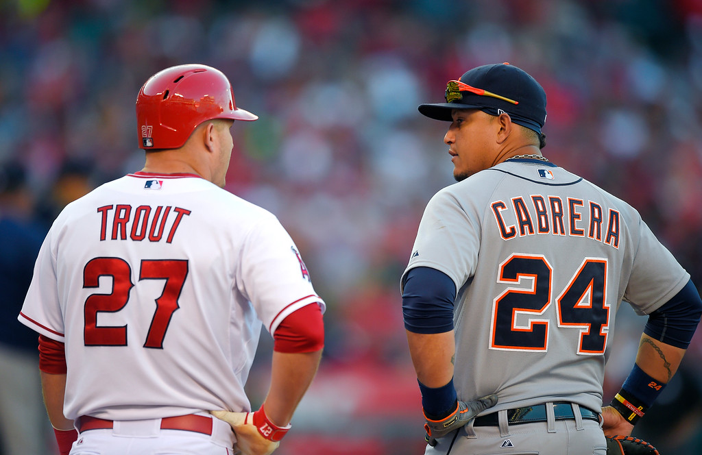 . Los Angeles Angels\' Mike Trout, left, and Detroit Tigers first baseman Miguel Cabrera talk at first base during the fifth inning of a baseball game, Sunday, May 31, 2015, in Anaheim, Calif. (AP Photo/Mark J. Terrill)
