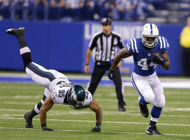 . Indianapolis Colts running back Ahmad Bradshaw (44) runs past Philadelphia Eagles inside linebacker Mychal Kendricks (95) during the first half of an NFL football game Monday, Sept. 15, 2014, in Indianapolis. (AP Photo/Michael Conroy)