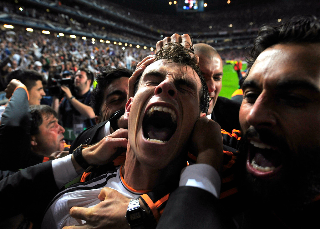 . Real Madrid\'s Gareth Bale celebrates with teammates after scoring his side\'s second goal in the Champions League final soccer match against Atletico Madrid at the Luz Stadium in Lisbon, Portugal, Saturday, May 24, 2014. Real Madrid won 4-1 in extra time. (AP Photo/Manu Fernandez, File)