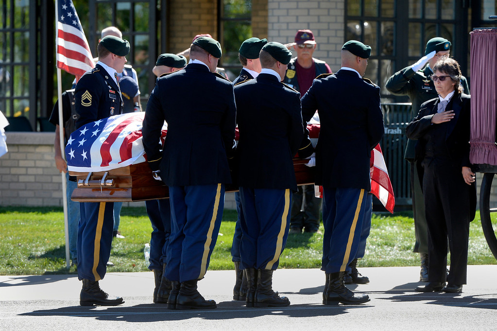 . DENVER, CO. - OCTOBER 02: Pallbearers carry Colorado National Guard Special Forces Soldier Liam Nevins to a burial service at Fort Logan National Cemetery in Denver,CO October 02, 2013. (Photo By Craig F. Walker / The Denver Post)