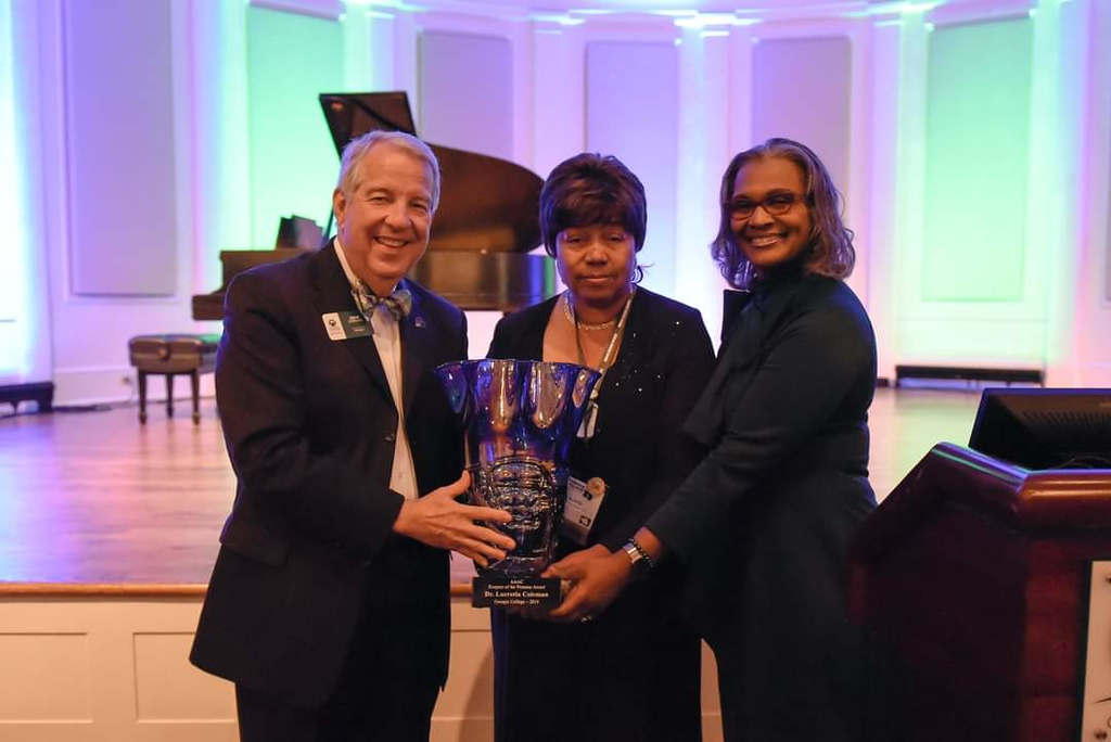 Georgia College President Dr. Steve Dorman and AAAC President Debra Minor with Dr. Lucretia Coleman (center) receiving the Keepers of the Promise Award.