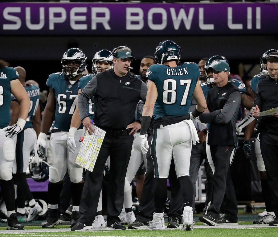 . Philadelphia Eagles head coach Doug Pederson talks to Brent Celek during the first half of the NFL Super Bowl 52 football game against the New England Patriots Sunday, Feb. 4, 2018, in Minneapolis. (AP Photo/Mark Humphrey)
