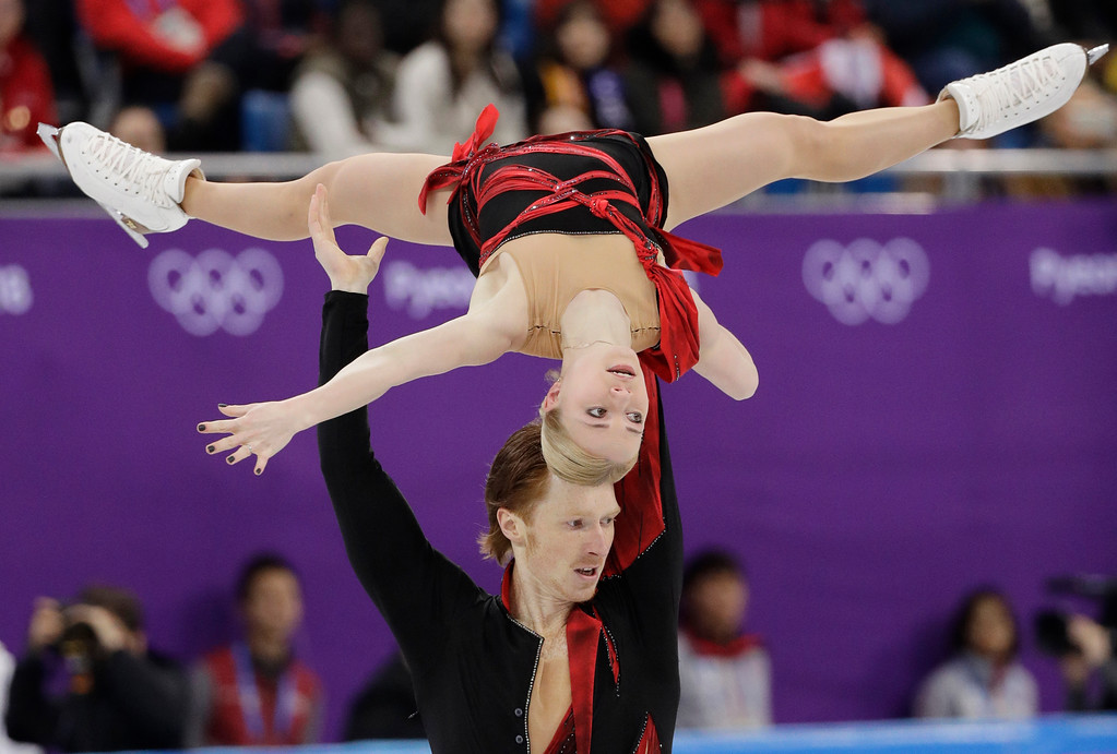 . Evgenia Tarasova and Vladimir Morozov of the Olympic Athletes of Russia perform in the pair figure skating short program in the Gangneung Ice Arena at the 2018 Winter Olympics in Gangneung, South Korea, Wednesday, Feb. 14, 2018. (AP Photo/David J. Phillip)
