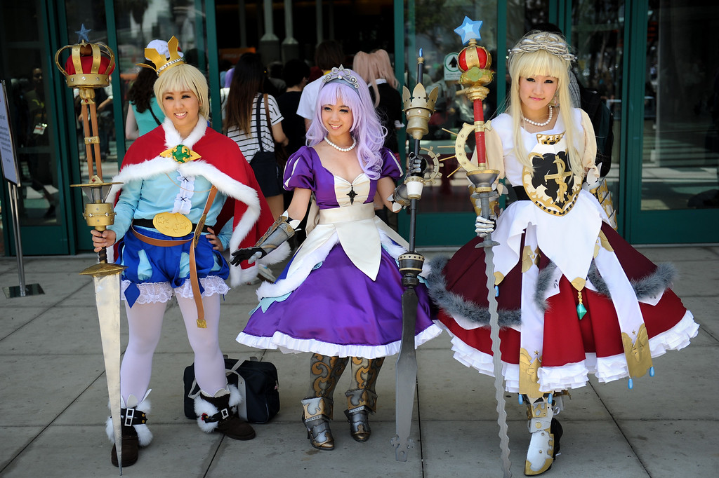 . Terri Liaw, from left, Paulina Nguyen and Ariel Chen are dressed as characters from the Ecchi and Odyssey video game at the Anime Expo at the L.A. Convention Center, Saturday, July 6, 2013. (Michael Owen Baker/L.A. Daily News)