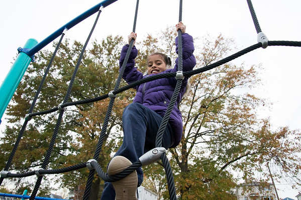 11/04/19 Wesley Bunnell | StaffrrA ribbon cutting was held at Chesley Park celebrating the completion of the Phase 2 renovation project. Alyin Sanchez, age 8, climbs a rope obstacle.