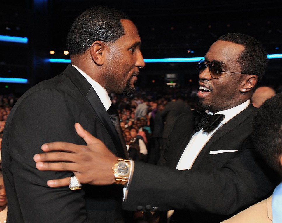 """. Ray Lewis, left, and Sean \""""P. Diddy\"""" Combs speak in the audience at the ESPY Awards on Wednesday, July 17, 2013, at Nokia Theater in Los Angeles. (Photo by Jordan Strauss/Invision/AP)"""