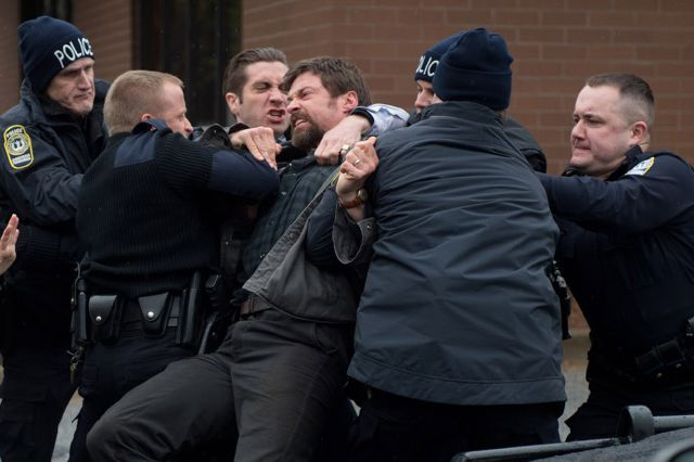 """. This image released by Warner Bros. Pictures shows Hugh Jackman, cener, and Jake Gyllenhaal, third from left, in a scene from \""""Prisoners.\"""" (AP Photo/Warner Bros. Pictures, Wilson Webb)"""