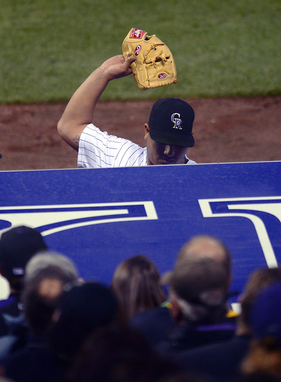 . Colorado pitcher Jhoulys Chacin threw his glove into the dugout after he was pulled from the game in the sixth inning. He had just allowed a home run to Pablo Sandoval. The Colorado Rockies hosted the San Francisco Giants Wednesday night, May 21, 2014.  (Photo by Karl Gehring/The Denver Post)