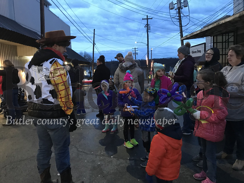 Youth at the the 6th annual Chicora Light-Up Night on Sunday had a chance to meet the characters Woody and Jessie from Toy Story. Photo by Gabriella Canales.