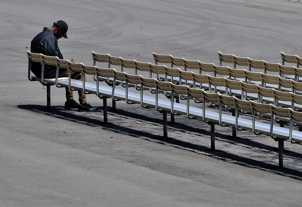 . 0510-NWS_TDB-L-HOLLYPARK--20130509-- Photo: Robert Casillas / LANG    Hollywood Park in Inglewood will be closing at end of year. An early bird bettor sits in empty seating area.