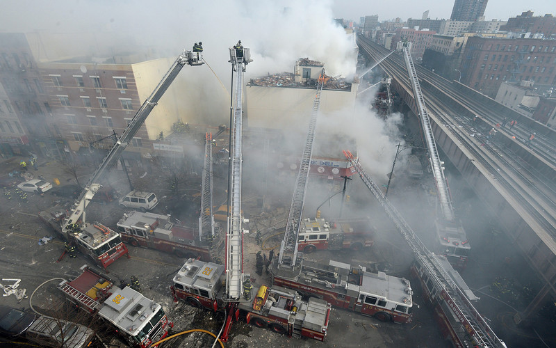 Description of . Firefighters try to put out a fire after a reported explosion and building collapse in the Harlem area of New York City, New York, USA, 12 March 2014. The cause of the explosion, as well as reports of any injuries, had not yet been determined.  EPA/JUSTIN LANE