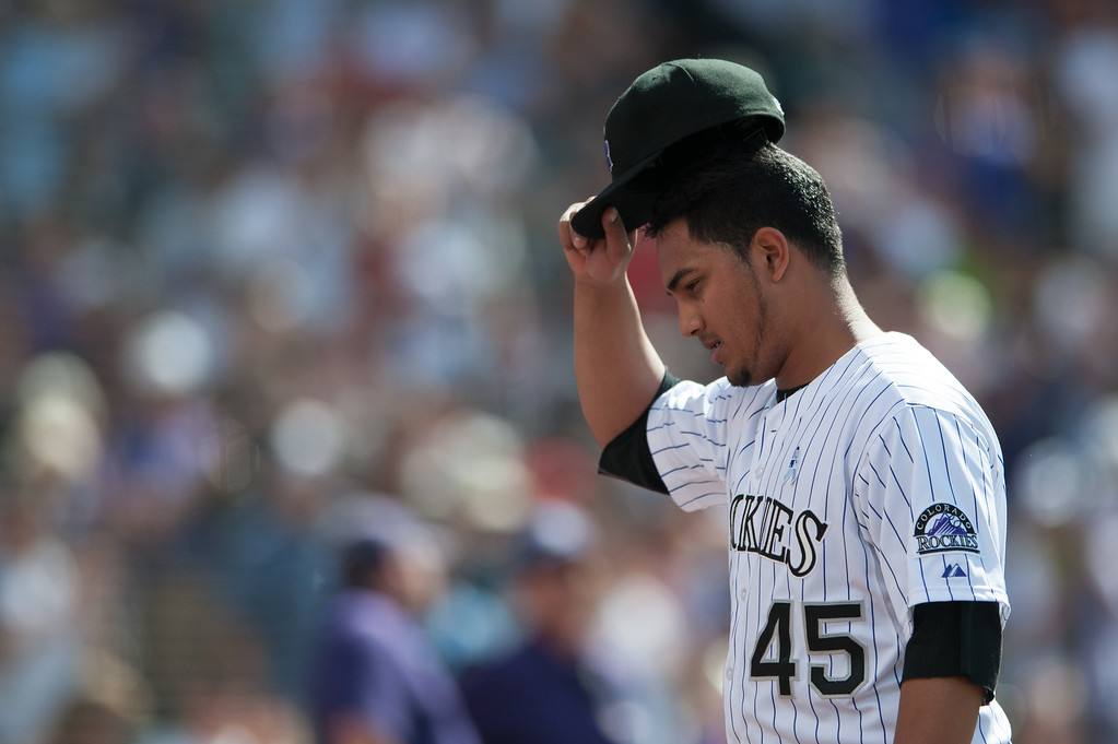 . DENVER, CO - JUNE 16:  Jhoulys Chacin #45 of the Colorado Rockies tips his hat to the crowd after being relieved in the top of the ninth inning of a game against the Philadelphia Phillies at Coors Field on June 16, 2013 in Denver, Colorado. The Rockies beat the Phillies 5-2. (Photo by Dustin Bradford/Getty Images)