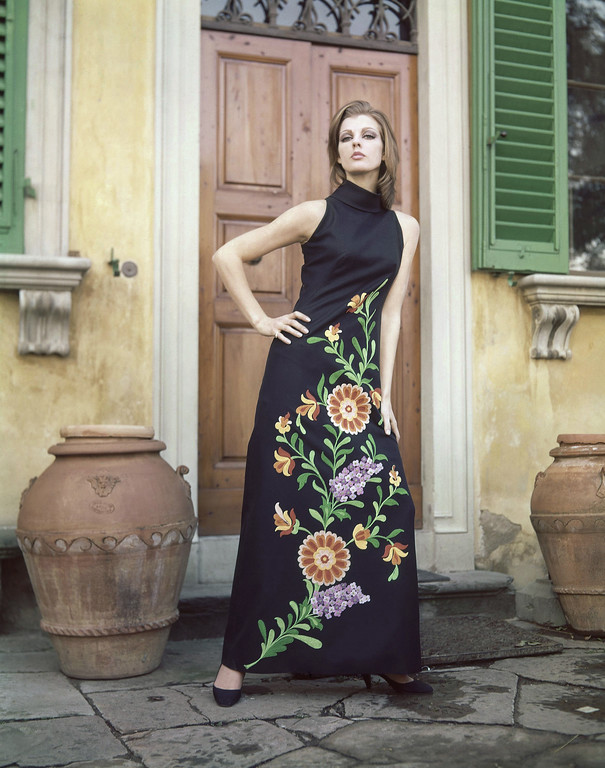. An evening dress of black panama with hand-embroidered twigs leaves and flowers in orange-red, violet and green colors. It is a creation by the Gi-Bo fashion house of Florence and Milan and was presented at the Florence show of Italian spring and summer fashions in Italy, Jan. 18, 1965. (AP Photo/Mario Torrisi)