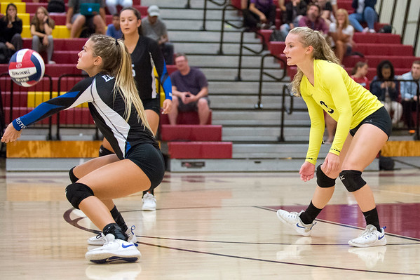 09/16/19 Wesley Bunnell | StaffrrBristol Eastern's Zoe Lowe (7) receives a serve as teammate Rebecca Bender (3) looks on during a game against New Britain on Monday night at New Britain High School.