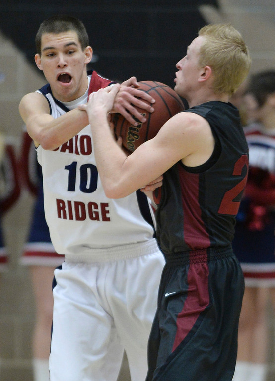 . LITTLETON, CO. - JANUARY 17: Dakota Ridge guard Cody Pittman (10) tried to take the ball from Chatfield\'s Autin Rice (20) in the first half. The Dakota Ridge High School boy\'s basketball team hosted Chatfield Friday night, January 16, 2014. Photo By Karl Gehring/The Denver Post
