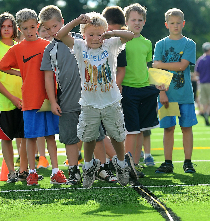 . Fourth-grader Conner Horton, 9, has his jump measured during drills.  (Pioneer Press: Sherri LaRose-Chiglo)