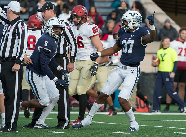 11/23/19 Wesley Bunnell | StaffrrYale rallied late in The Game against Harvard on Saturday afternoon at the Yale Bowl for a 50-43 victory in double over time. DB Jaelin Alburg (6) and DB Dathan Hickey (37) celebrate a Harvard turnover.