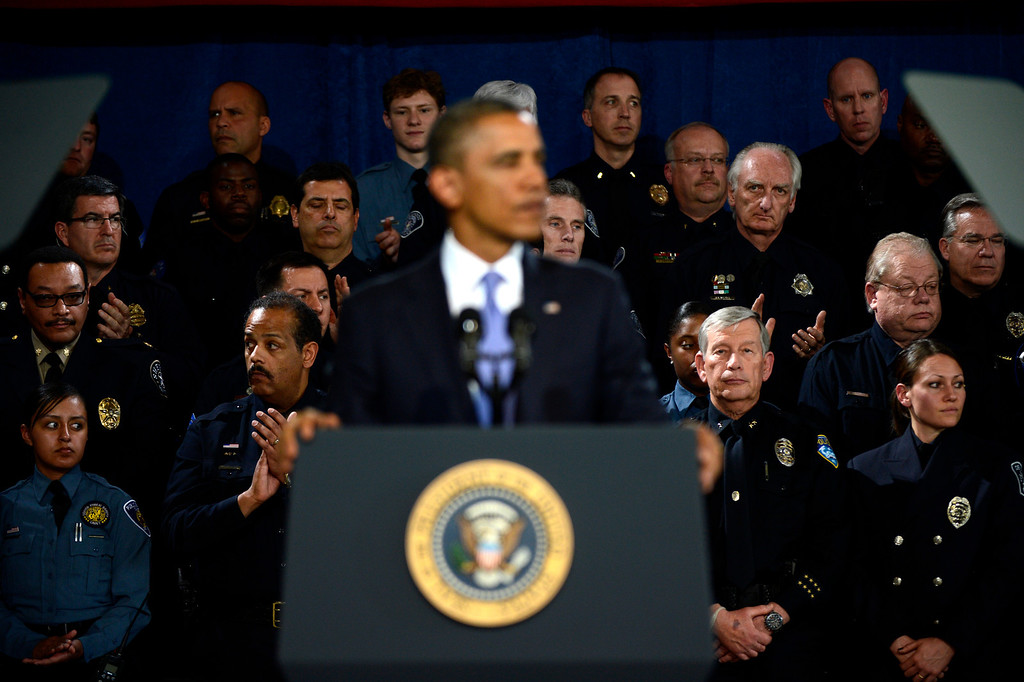 . DENVER, CO. - APRIL 03: Officers clap as President Barack Obama speaks to uniformed officers and community leaders at the Denver Police Academy calling for Congress to act more like the state\'s Democratic-controlled legislature to pass stronger gun-control laws. (Photo By Joe Amon/The Denver Post)
