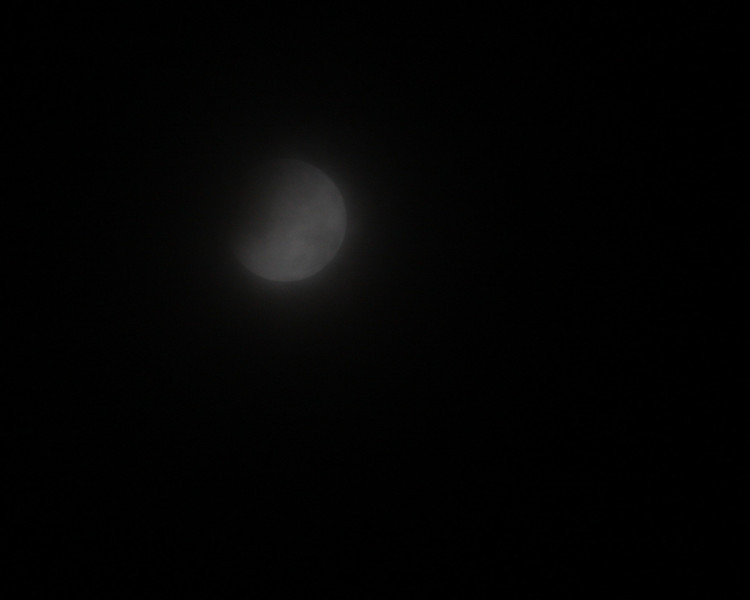 The eclipse on a foggy night.
