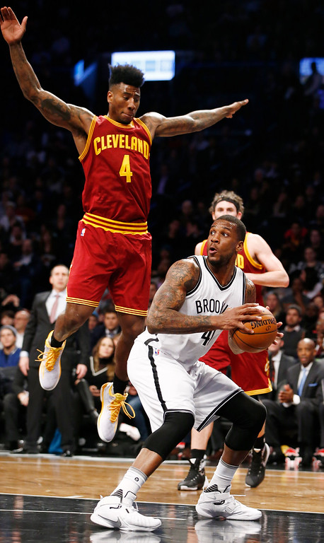 . Cleveland Cavaliers guard Iman Shumpert (4) defends Brooklyn Nets forward Thomas Robinson (41) who looks for an opening in the second half of an NBA basketball game, Wednesday, Jan. 20, 2016, in New York. The Cavaliers defeated the Nets 91-78. (AP Photo/Kathy Willens)