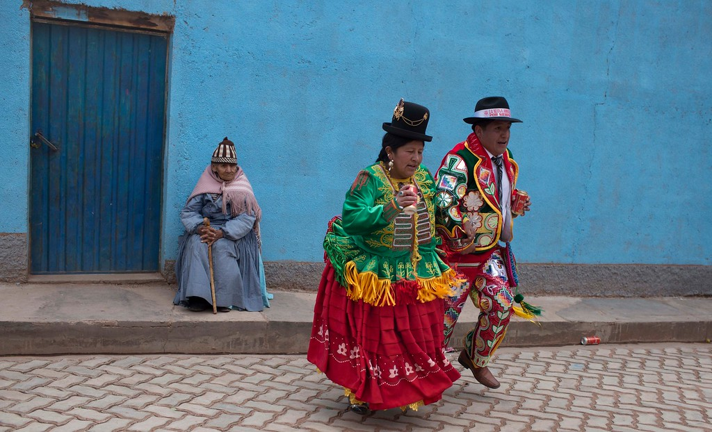 . A couple in costume dances during the start of the Andean carnival in Caquiaviri, Bolivia, Tuesday, Jan. 17, 2017. Caquiaviri opens the carnival celebrations in Bolivia with a 4-day festival where local people get dressed in costumes and the streets get filled by orchestras and bands, traditional dances and bullfights. (AP Photo/Juan Karita)
