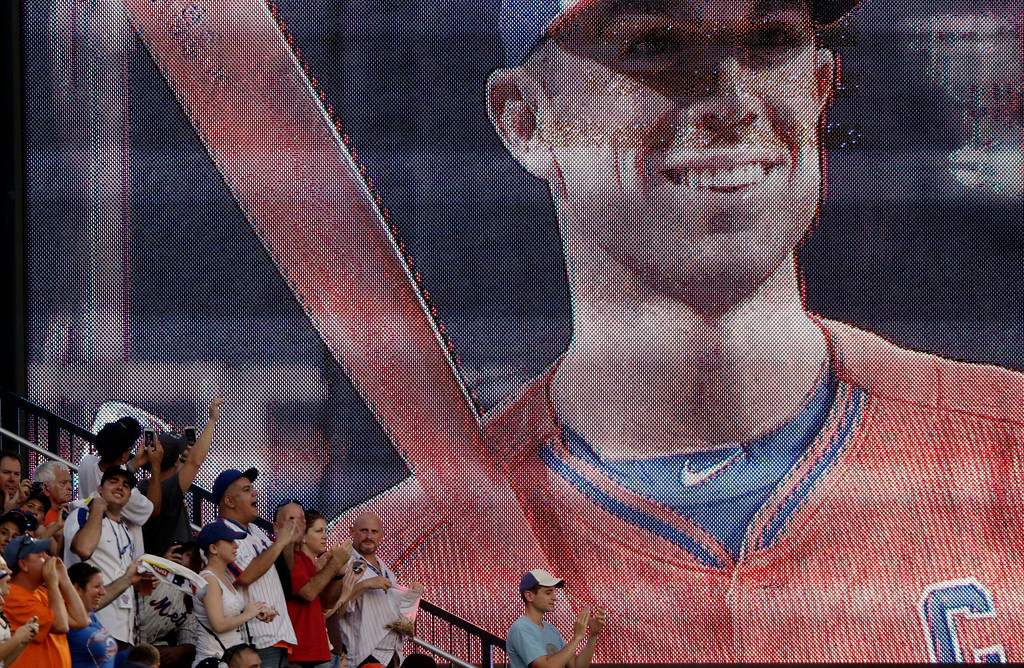 . Fans cheer as National League\'s David Wright of the New York Mets is introduced before the MLB All-Star baseball Home Run Derby, Monday, July 15, 2013, in New York. (AP Photo/Frank Franklin II)