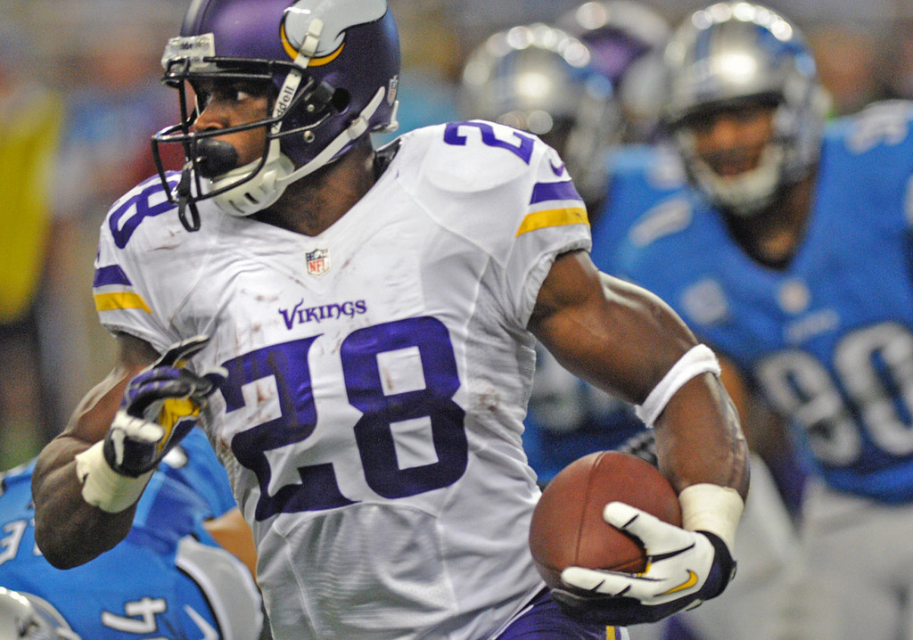 . Vikings running back Adrian Peterson carries the ball for a short gain in the second quarter against the Lions. Peterson opened the season with a huge play, as he took his first touch 78 yards for a touchdown. He  totaled just 15 more yards on his final 17 carries. (Pioneer Press: Chris Polydoroff)
