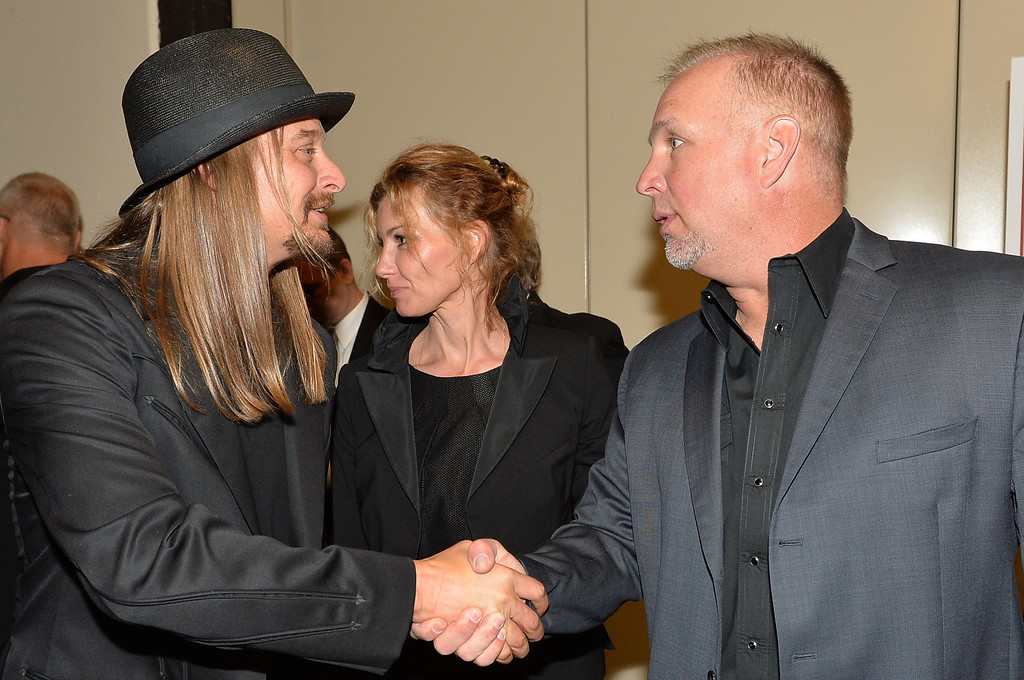 . (L-R) Country musicians Kid Rock, Faith Hill, and Garth Brooks attend the funeral service for George Jones at The Grand Ole Opry on May 2, 2013 in Nashville, Tennessee. (Photo by Rick Diamond/Getty Images for GJ Memorial)