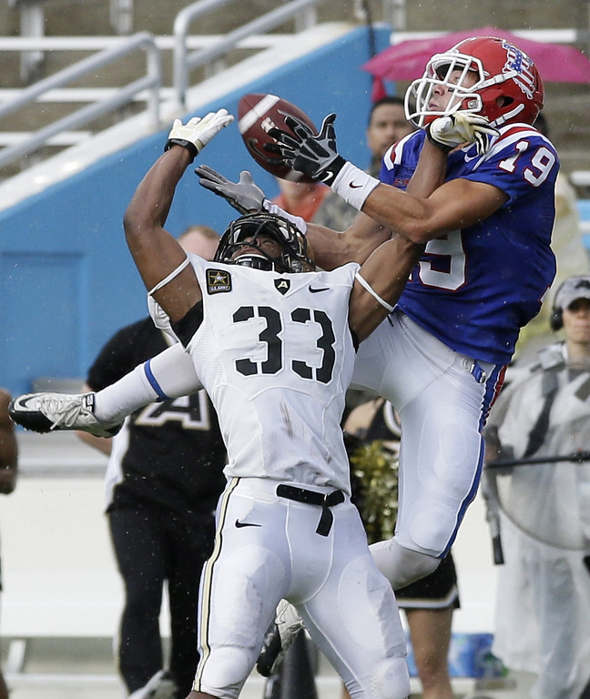 . Army defensive back Shaquille Tolbert (33) defends as Louisiana Tech wide receiver Andrew Guillot (19) comes down with a reception in the end zone for a touchdown in the first half of a NCAA college football game, Saturday, Sept. 28, 2013, in Dallas. (AP Photo/Tony Gutierrez)
