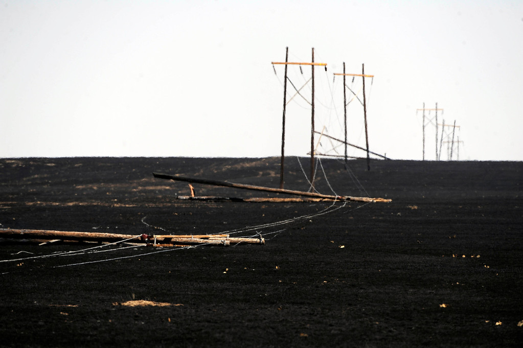 . Power lines are down along Highway 71 near Last Chance, Colorado as a result of the Last Chance Fire that scorched over 45,000 acres, burning several homes and many out buildings. Andy Cross, The Denver Post