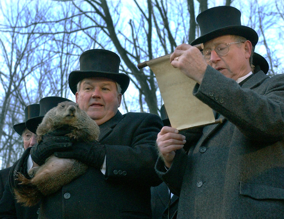 . Handler Bill Deeley holds Punxsutawney Phil, left, as Punxsutawney Groundhog club President William Cooper reads the proclamation that there would be six more weeks of winter after Phil saw his shadow in Puxsutawney, Pa. on Wednesday, Feb. 2, 2005  (AP Photo/Keith Srakocic)