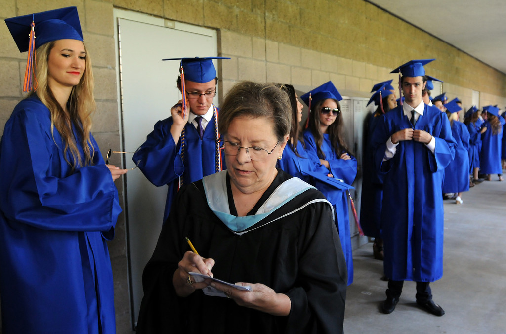 . Dean of Students, Barbara Tweedy, helps organize students before the ceremony.  Chaminade College Preparatory High School, celebrating its 60th anniversary, graduated 337 students at the West Hills campus on Saturday, June 01, 2013.  (Dean Musgrove/Los Angeles Daily News)