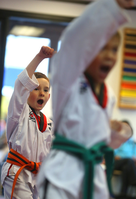 . Sammy Masek, 6, left, takes part in a  martial arts class on Monday, Feb. 11, 2013 in Pleasanton, Calif.  Masek is one of a growing number of children that have lost their diagnosis of autisim.  (Aric Crabb/Staff)