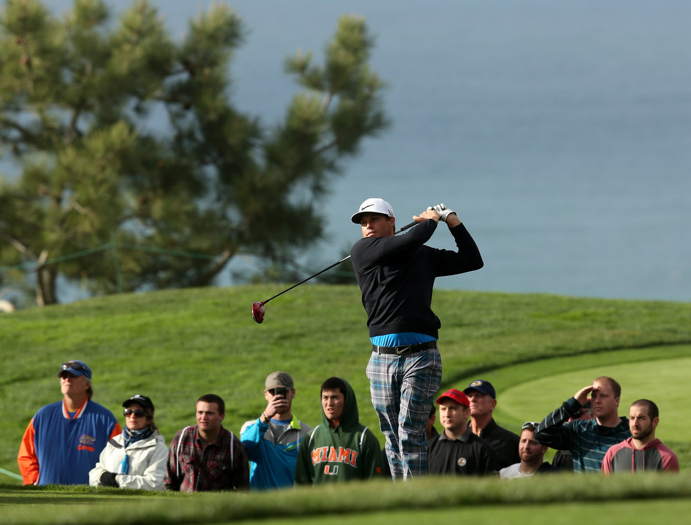 Description of . Nick Watney hits his tee shot on the second hole during the final round of the Farmers Insurance Open on the South Course at Torrey Pines Golf Course on January 27, 2013 in La Jolla, California.  (Photo by Stephen Dunn/Getty Images)
