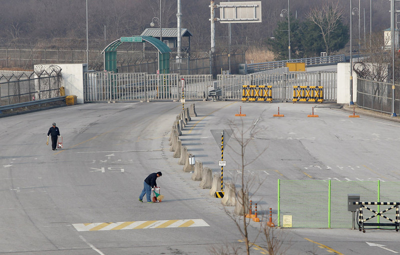 . South Korean mans cleaning at empty road connection Kaesong Industrial Complex (KIC) with South\'s CIQ (Customs, Immigration, Quarantine) at  inter-Korean transit office in Paju on April 4, 2013 in Paju, South Korea. 400 South Koreans remain in the joint industrial complex fearing they can not get back there once return to South. In recent weeks North Korea have threatened to attack South Korea and U.S. military bases.  (Photo by Chung Sung-Jun/Getty Images)