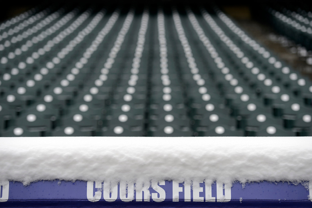 . An overnight storm hit the area covering the field at Coors field to force a double header with the Colorado Rockies and the New York Mets April 16, 2013 at Coors Field. (Photo By John Leyba/The Denver Post)