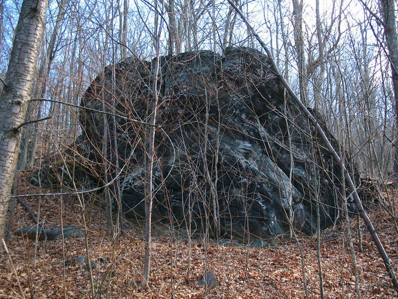 A huge rock outcrop near the ridge...
