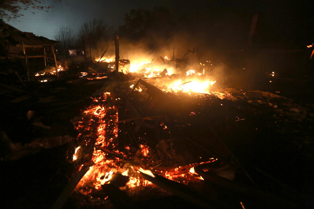 . The remains of a home burn early Thursday morning, April 18, 2013, after a fertilizer plant exploded Wednesday night in West, Texas. The massive explosion killed as many as 15 people and injured more than 160, shaking the ground with the strength of a small earthquake and leveling homes and businesses for blocks in every direction. (AP Photo/LM Otero)
