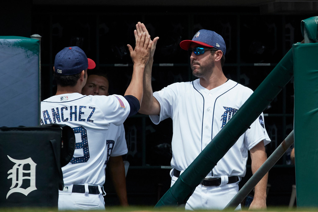 . Detroit Tigers relief pitcher Anibal Sanchez (19) high fives with Justin Verlander after being relieved against the Cleveland Indians during the seventh inning in the first baseball game of a doubleheader in Detroit, Saturday, July 1, 2017. (AP Photo/Rick Osentoski)