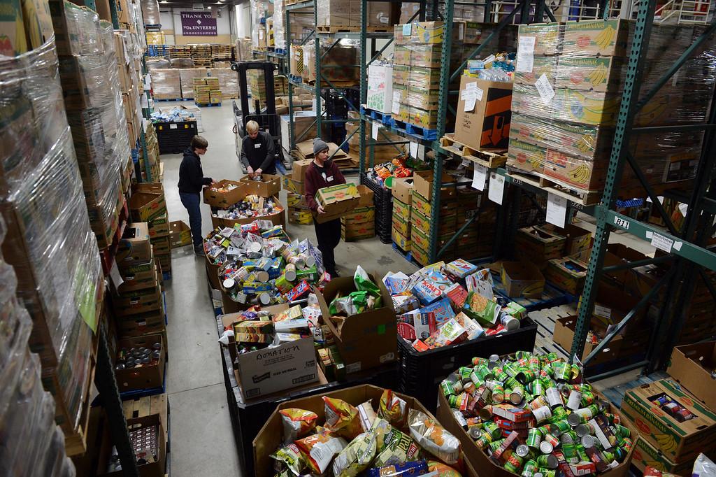 . Volunteers sort donated food at the Community Food Share in Longmont, CO, Thursday December 27, 2012.  Craig F. Walker, The Denver Post