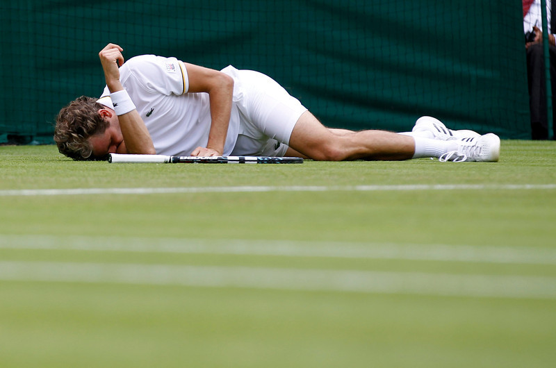 . Julien Benneteau of France lays on the court after slipping over as he plays Fernando Verdasco of Spain during their Men\'s second round singles match at the All England Lawn Tennis Championships in Wimbledon, London,  Wednesday, June 26, 2013. (AP Photo/Sang Tan)