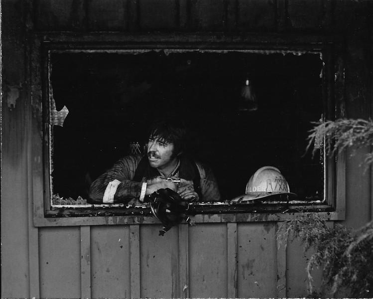 Ken Holder in window.jpg
