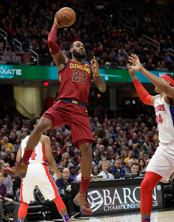 . Cleveland Cavaliers\' LeBron James (23) shoots against Detroit Pistons\' Tobias Harris (34) in the first half of an NBA basketball game, Sunday, Jan. 28, 2018, in Cleveland. (AP Photo/Tony Dejak)